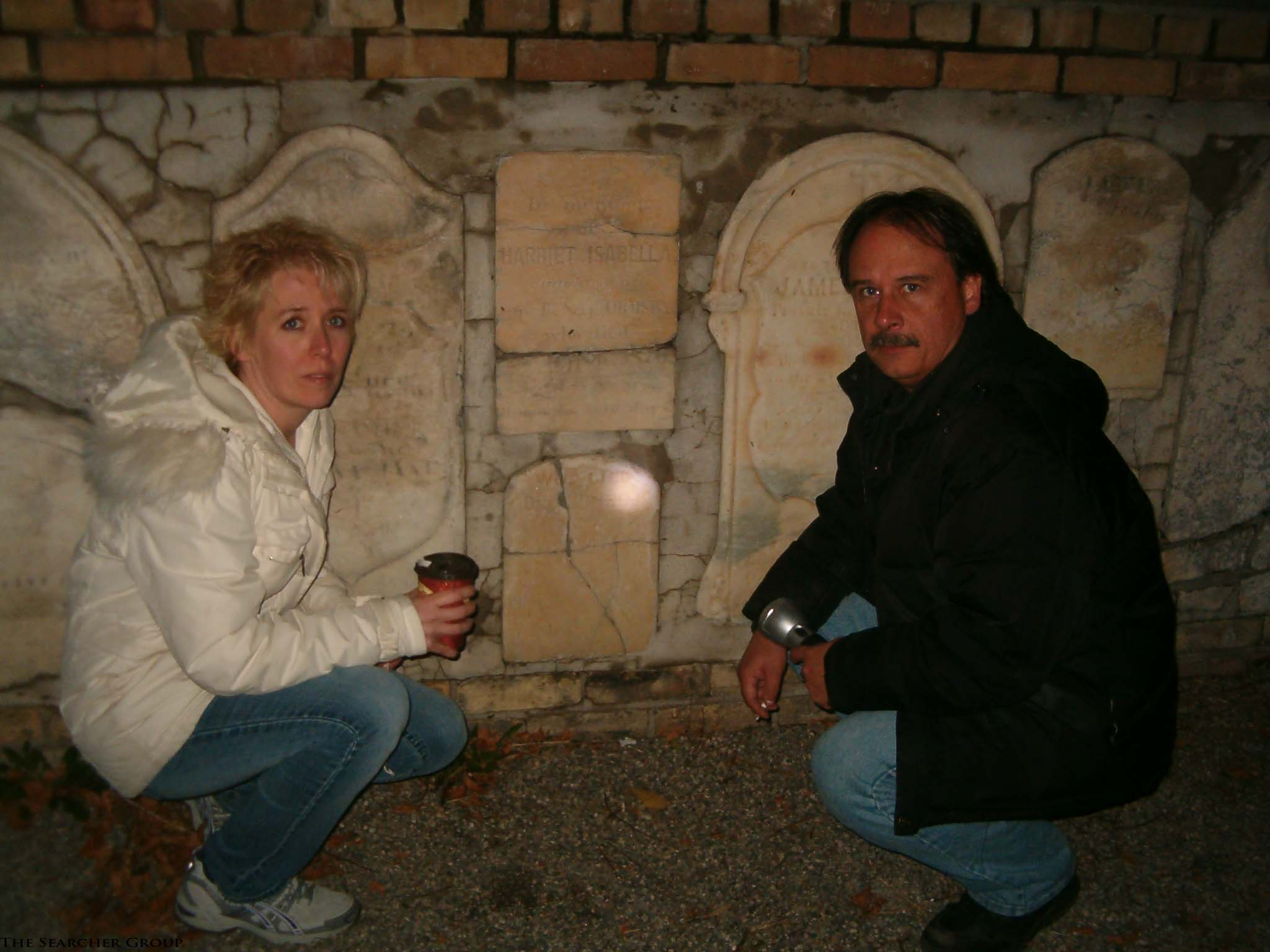 photo of Richard and Michelle crouched in front of tombstones