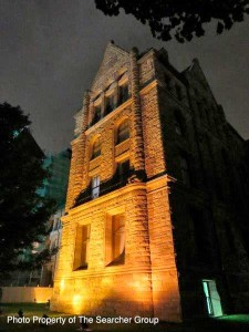 Photo of exterior of Queens Park at night
