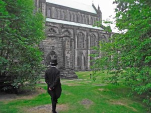 Castle with man in black suit and top hat standing out front